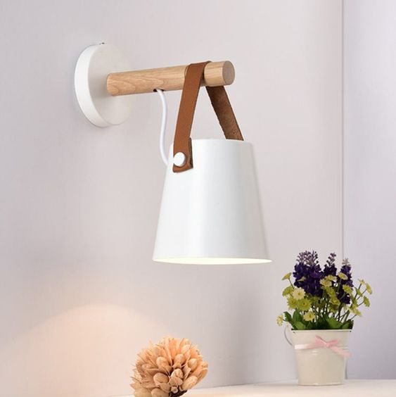 Nodic Wooden Hanging Wall Lamp is a contemporary countryside design. It is made from a iron shade (bent under high temperature) and a wooden handle. Add contemporary nordic styles into any room of your resident space with these wooden hanging wall lamp