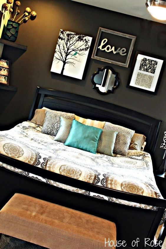 Charcoal bedroom. I've always loved dark colored bedrooms. I love this one. The white it the frames on the wall, and in the bedspread does a great job of lightening things up.