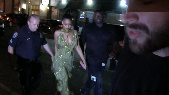 Green with envy! Rihanna steps out in green dress after Drakes Video Music Awards declaration of love. Rihanna's dress features several frills and shined as she paired it with matching shoes and a choker.