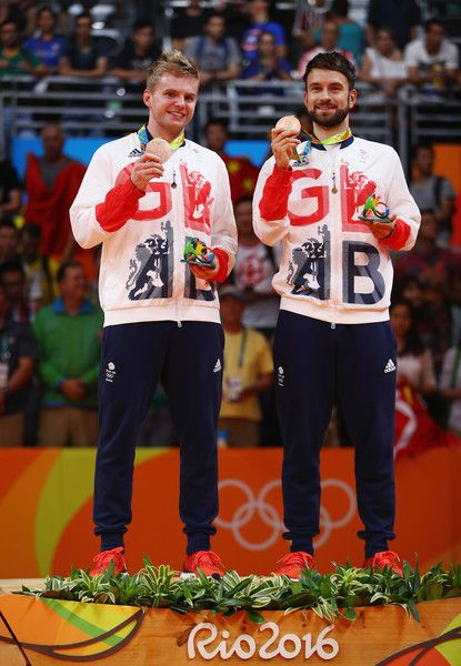 L-R) Bronze medalists Marcus Ellis and Chris Langridge of Great Britain stand on the podium during the medal ceremony after the Men's Badminton Doubles competition on Day 14 of the Rio 2016 Olympic Games at Riocentro - Pavilion 4 on August 19, 2016 in Rio de Janeiro, Brazil.