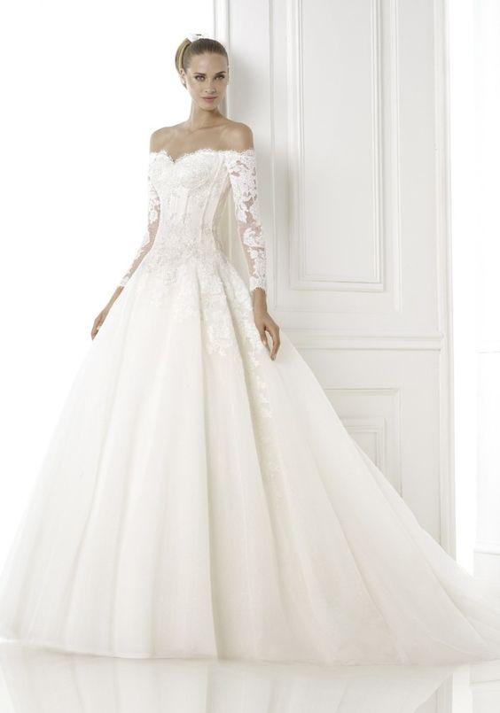Pronovias 2015 Collection. Off-the-shoulder wedding dress.  Available at Designer Bridal Room