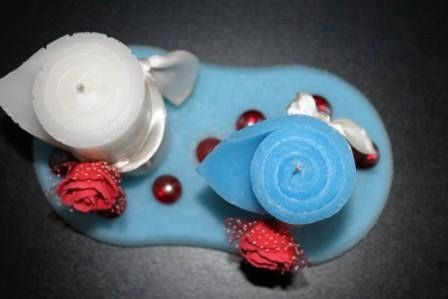 https://flic.kr/p/ABRbrq | CENTERPIECE OF WAX; CENTROTAVOLA IN CERA | Centerpiece of wax, consisting of 2 rolled candles - one white and one light blue – on the size of about 45 x 95 mm, decorated with a felt red rose on white tape; oval flat of wax, white and light blue colors. Dimensions: 180 mm x 90 mm. With decoration of 6 shiny red stones and 1 matte red stone. 100% natural essential oil with tea fragrance. Handmade.  To learn more visit:  www.ilmiomondoincera.com    Centrotavola in…