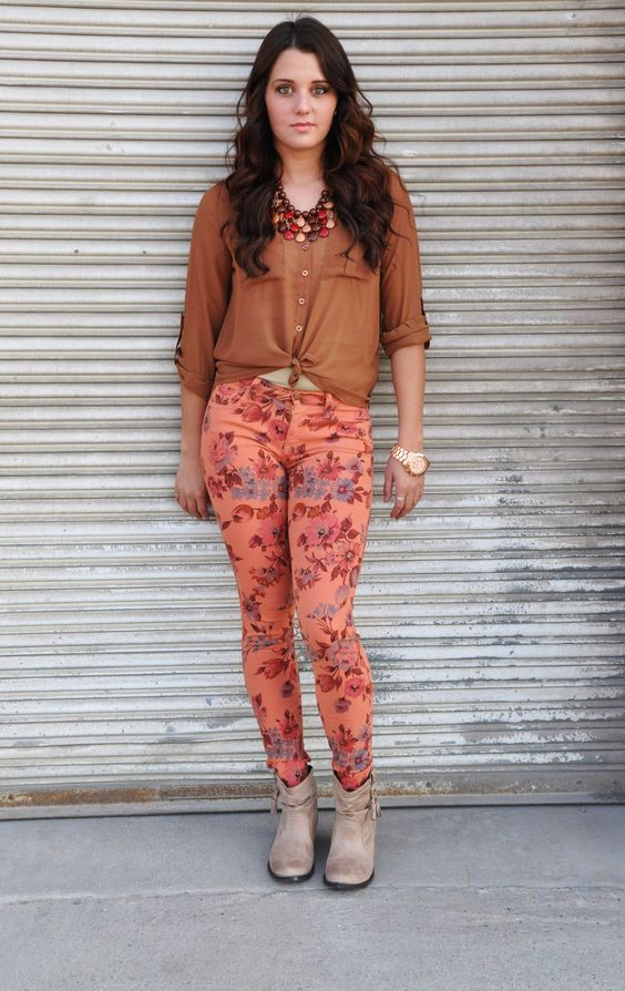 Get ready for fall fashions with this great ensemble. A cognac button down top that you can tie at the bottom, along with floral jeggings and cute booties to complete the look!