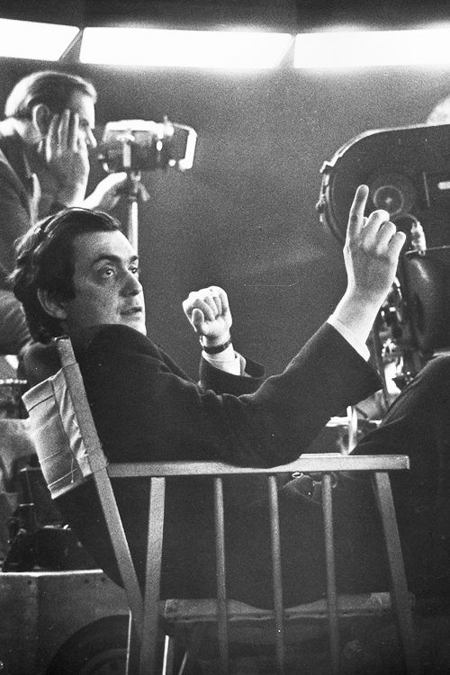Stanley Kubrick sits near a movie camera on the set of his film, Dr. Strangelove or: How I Learned to Stop Worrying and Love the Bomb,Shepperton Studios, England, 1964.