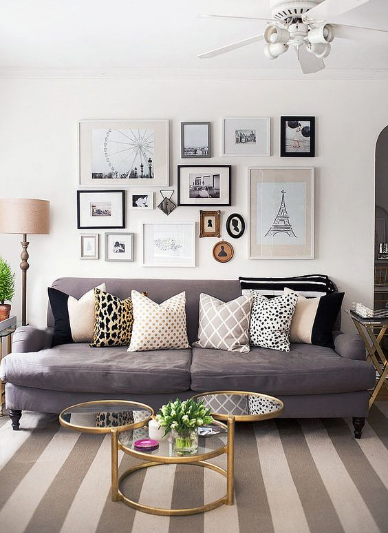 When making a gallery wall, copy the mismatched photo stacking of this girlie living room. Different sizes, frames, and levels help your living room look less like a gallery and more like a home.: