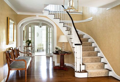 Love the curves in the staircase and archway.