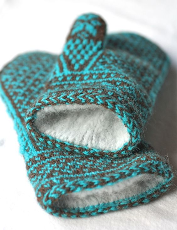 Doubled mitten. Knit 2 mittens of different colors, stitch together at openings and fold one inside the other. (Maybe make inside mitten a little smaller than outside one.)