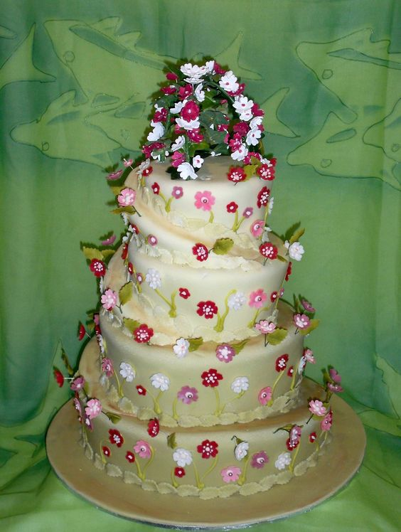 green with blossoms and bike rider topsy turvey wedding cake