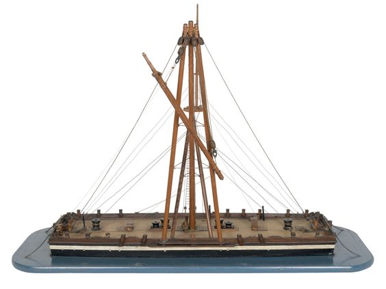 81 (1800); Service vessel; Sheer hulk - National Maritime Museum- Scale: 1:48. A contemporary waterline model of a floating sheer hulk (1800) mounted on a painted baseboard. The square and shallow hull is complete with a variety of equipment on deck, in particular are four large capstans used for working the sheer legs and the mooring chains over the bow and stern. The sheer legs themselves have been made in a metal tubing and with the associated rigging, it is clear that this model was used…