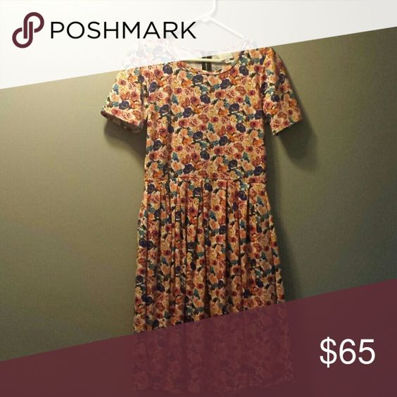 *PRICE REDUCED* Flowered Amelia Dress Multi colored. Excellent condition! Wore just a few hours. LuLaRoe Dresses Asymmetrical