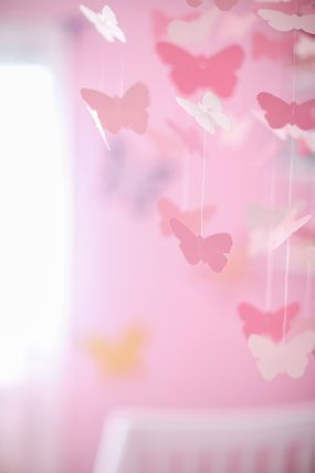 pink butterfly themed baby girl nursery room mobile over crib