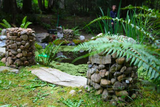 Have a few too many rocks in your garden? Save them and turn them into stone pillars and planters!