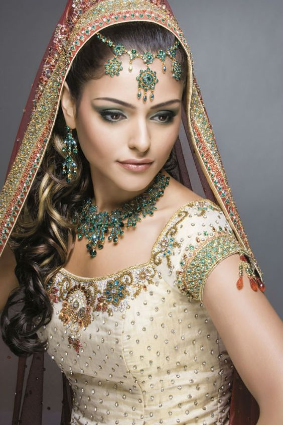 White dress red sari blue green & gold accessories/accents -- wow she is truly breath taking...
