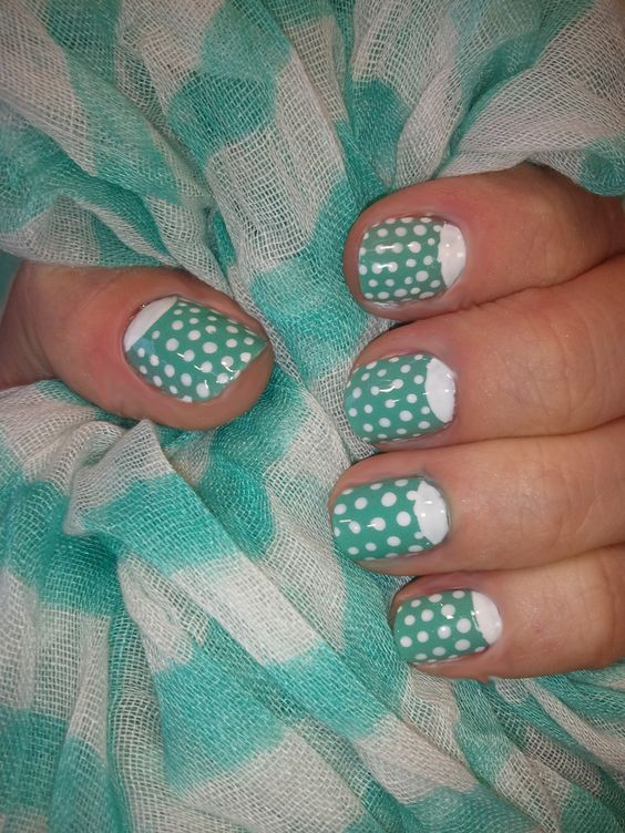 My vintage nails   base- essie: turquoise & caicos  moon and polka dots- essie: blanc