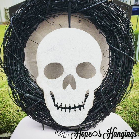 Feeling Spooky? Try this grinning skull wreath, if you dare!  #Halloween #Halloweenwreath #skeleton #skull #skullwreath #wreaths #grapevine #spooky #skeletonwreath #Fayetteville #grapevinewreath #fortbragg #fayettevillenc #fortbraggnc #hopeshangings #crafting #doordecor #homedecor #frontdoor #frontdoordecor