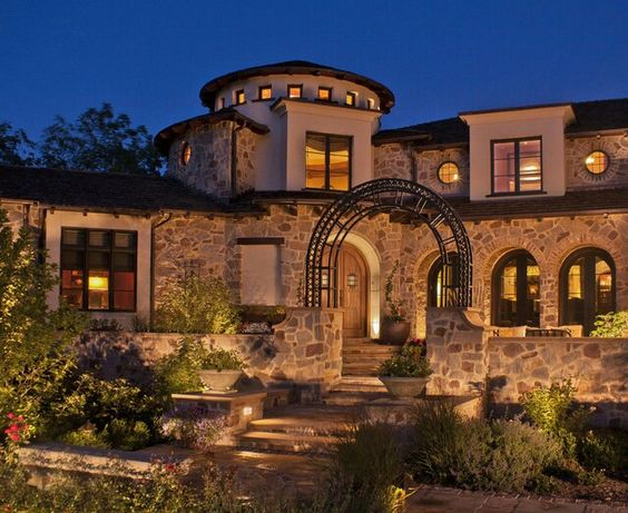 Tuscan exterior stone and stucco arch by deep river for Mediterranean stone houses