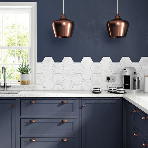 White Marble Hexagon Tile from British Ceramic Tile. These tiles are a great option if you want the marble look in your kitchen but without the maintenance of a marble worktop.