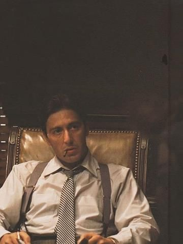Al Pacino as Michael Corleone, The Godfather.  Al in suspenders (as Ted Mosby would say):  Pulling.  Them.  Off.