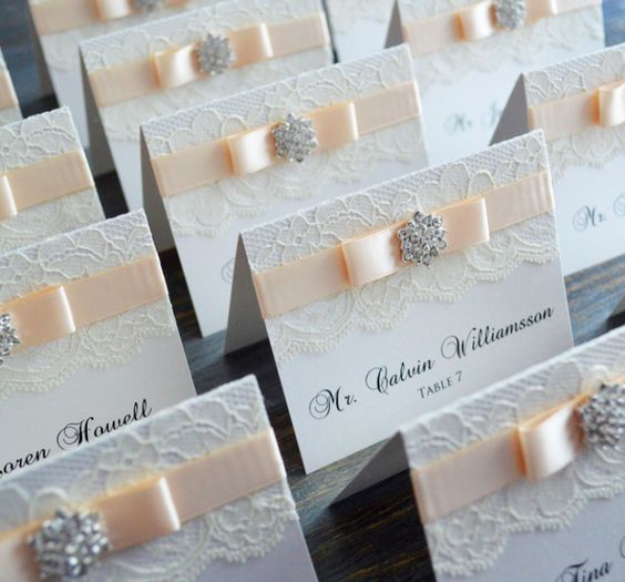 No one said that escort cards have to be just plain paper. Make sure your lace wedding ideas don't go to waste and whip out the glue gun! Adding a bit of lace to an escort card adds texture and charm to your day.