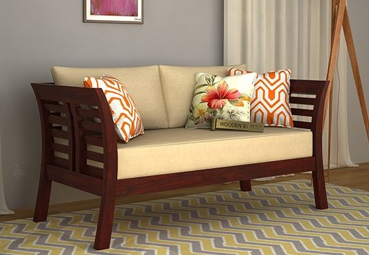 Simple And Elegant This Is How Darwin 2 Seater Wooden Sofa With Beautiful Mahogany Finish C Wooden Sofa Designs Wooden Sofa Set Designs Living Room Sofa Design