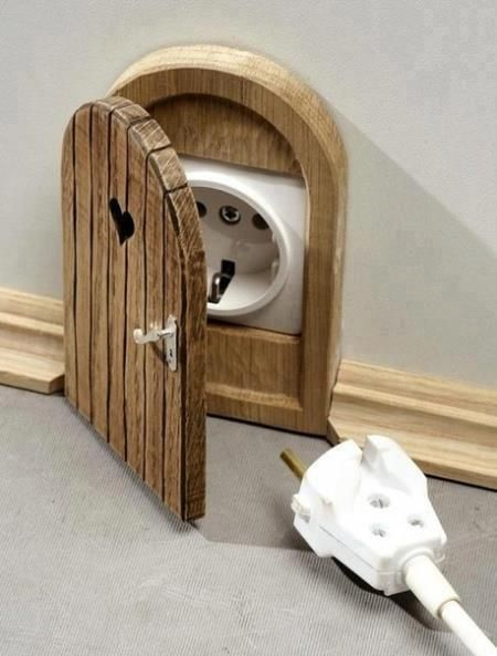 Ooer - little mouse doors for the lounge, steam punk ones for the kitchen, 20000 leagues under the sea for the bathroom...