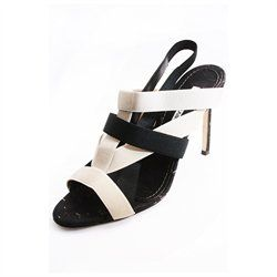 . Contrast two-tone elastic straps . Slingback . Metallic flecked cork insold . Leather outsole . Approx 3-3/4 cork covered heel. *Runs a little small . *Pre-owned .