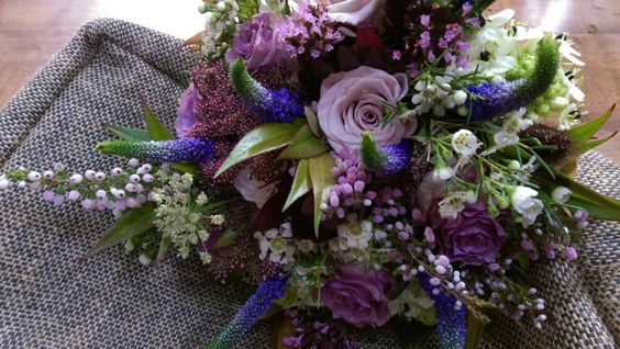 Rustic Bridal bouquet of purple vintage roses, heather, veronica and wax flower. www.enchantedflorals.co.uk