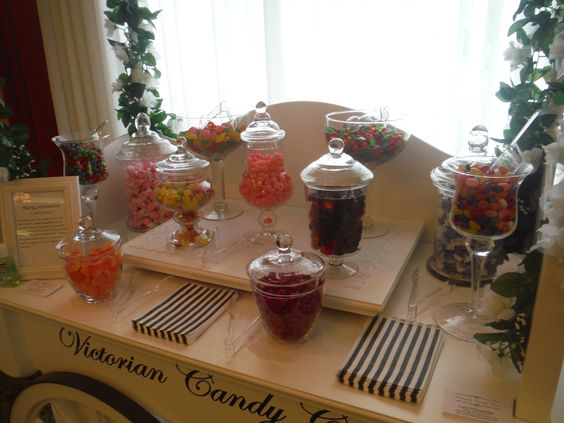 A display of your favourite candies are presented in elegant glassware or vintage mismatch china.
