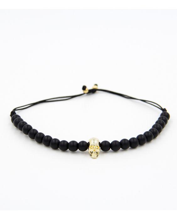 Produktdetails:   Farber: schwarz/gold  Perlen: 6mm matt onyx Naturstein  Zirkon: Totenkopf gold  Verschluss:  Jedes Armband ist ein Einzelstück! Alle unsere Armbänder werden in sorgfältiger Handarbeit mit Liebe zum Detail hergestellt.