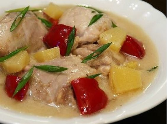 """Pininyahang Manok"" is chicken cooked in coconut milk with potatoes, pineapple and peppers.    Try this delicious and flavorful dish at Barrio Fiesta Dubai today!"