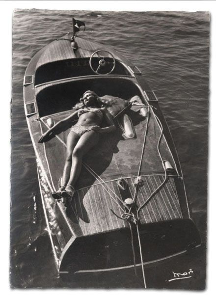 bathing beauty on wooden boat