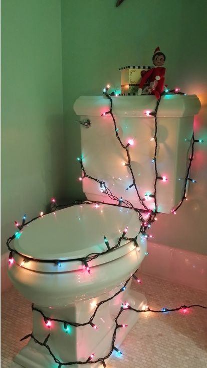 Elf on the Shelf Lights Up the Bathroom This elf got a little creative with the lights!