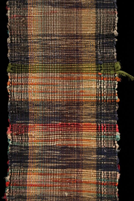 Sakiori obi, Japan. Made from old cotton fabric, this example has bands of brick red and aqua with some orange bands mixed in at the ends. One end has a more subtle ...