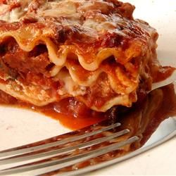 This is my mom's special homemade lasagna recipe with made from scratch tomato sauce and delicious, cheesy filling.  I have found none better anywhere.  Serve with a leafy green salad and crusty garlic bread, if desired.