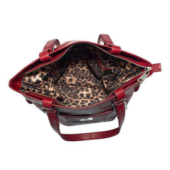Bella Grace Adele bag crafted in leather. Exterior pocket fits any Grace Adele clutch $200