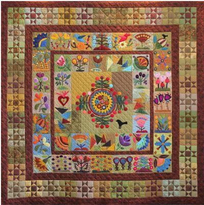 Folk Art Fantasy Raffle Quilt from Chaska, MN Area Quilt Club.  Featuring wool applique designs by Sue Spargo