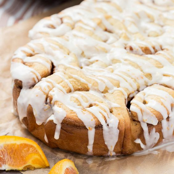 Orange Sweet Rolls that are made in the slow cooker! They are warm, buttery, and loaded with bold orange flavor.