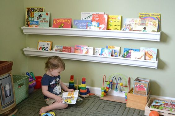 diy rain gutter bookshelves. looks like a fun play room or classroom idea.