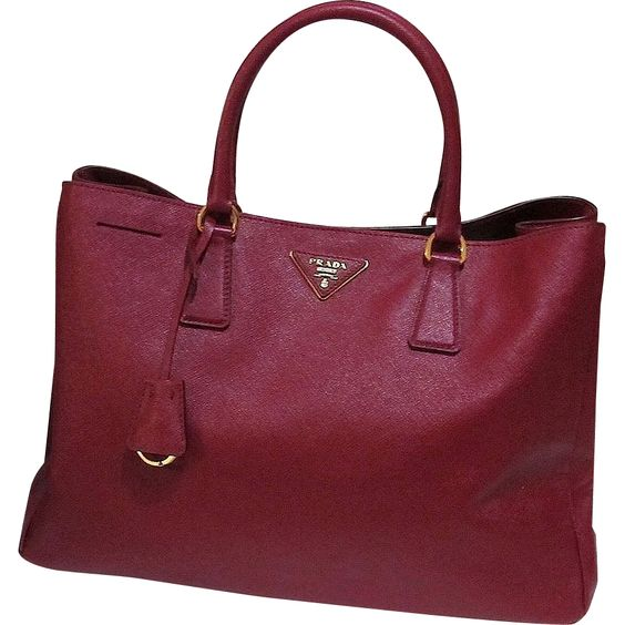 A Classic - Interior lining is signature fabric matched to the exterior. Large unobstructed center will hold pretty much anything. Prada construction is clean and sturdy. Saffiano textured & coated leather is nearly indestructible. Burgundy goes with just about anything making this a perfect bag to carry everywhere.