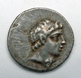 Greek silver drachm, of Ariathes V. Head of Eusebes Philapator on Obverse, Athena holding Nike, spear and shield on reverse. Ca 163 to 130 BCE.