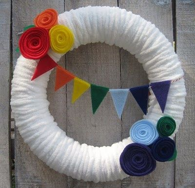 Things are slowly coming along for my daughter's rainbow birthday party. I managed to get the wreath done, now I'm getting ready to work on her t-shirt. Lot's to do still! But I want to go ahead & share the wreath. I started with a wreath form, some batting & tacky glue.