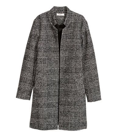 Black/checked. Short, gently fitted coat in woven fabric. Small stand-up collar, side pockets, and no buttons. Lined.