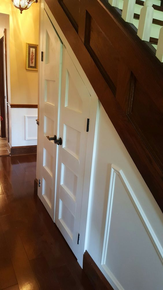 Love these doors under the stairs