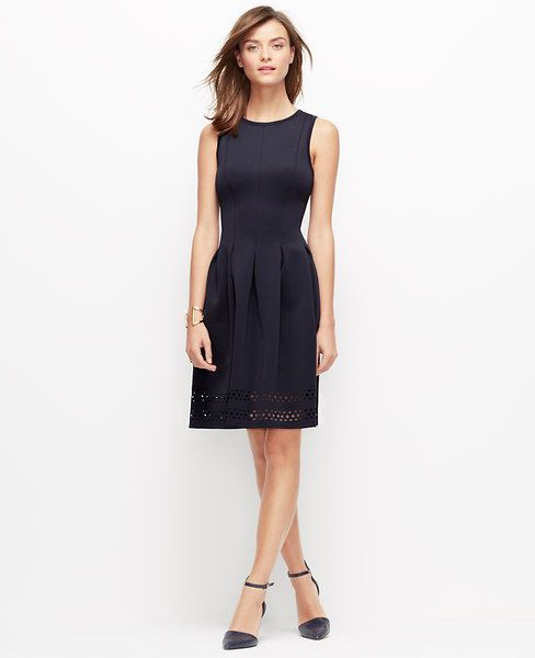 """A laser-cut hem and slight sheen intrigues this flattering stretch dress, redefining modern pretty. Pair with sleek ankle strap heels for the ultimate in ladylike luxe. Jewel neck. Sleeveless. Fitted bodice. Inverted box pleats at waist. Cutaway bands at hem. Hidden side zipper with hook-and-eye closure. 20"""" from natural waist."""