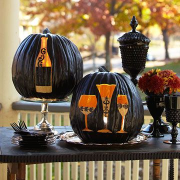 Dinner Party-Theme Pumpkins ~ Jack-o'-lanterns get an elegant makeover from a fresh coat of black paint and sophisticated designs.