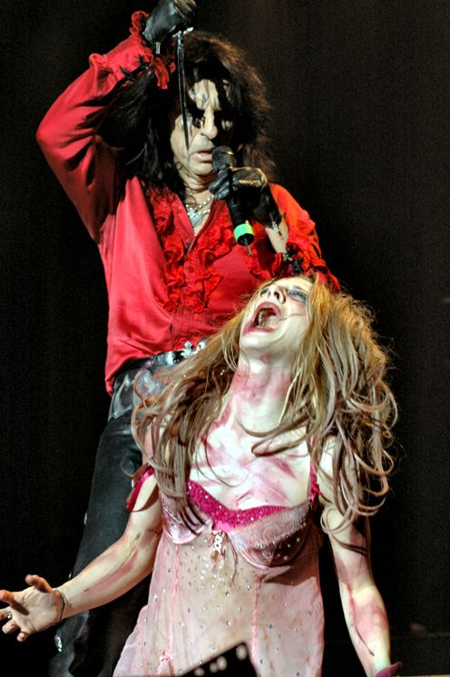 Alice Cooper and his daughter enjoying the spotlights together!