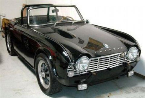 TR4 - one of my favorite sports cars of the past. My boss drove a yellow one.