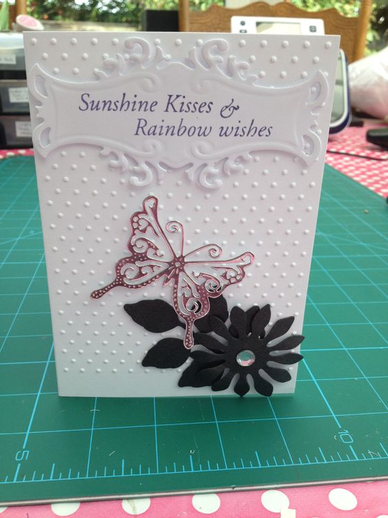 Swiss dots cuttle-bug embossing folder, spell binders sunflower and leaf die cut, Marrianne create-able butterfly die and Stamped then die cut spell binder sunshine wishes and rainbow kiesses.
