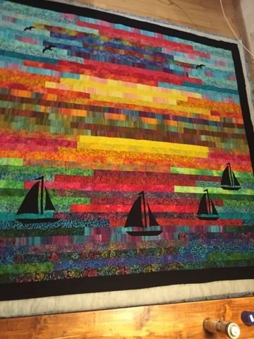 Sailboat quilt with batiks 'Sunset on the Sea'