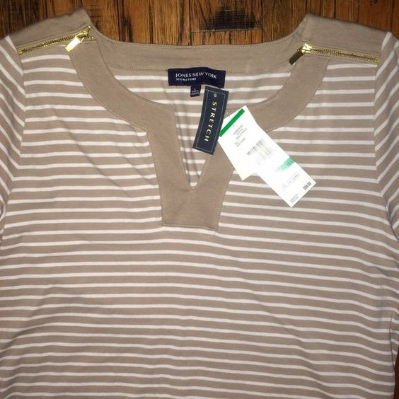 NWT Jones New York Striped Zipper Top This Jones NY top is so cute! It has tan and white stripes, gold zipper details at the collar, and a fun, yet appropriate neckline. The material is very comfy, making this the perfect classy T-shirt! Never worn and NWT, just too big for me! Jones New York Tops Tees - Short Sleeve